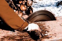 Man working with circular saw blade Stock Photography