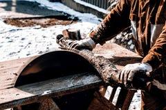 Man working with circular saw blade Stock Photo