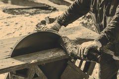 Man working with circular saw blade Stock Image