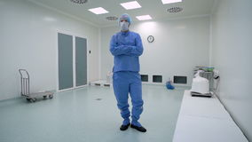 A man working in a clean room, pharmaceutical enterprise. Specialist in a protective suit, gloves, glasses and a mask. stock video