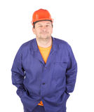 Man working clothes with arms in pockets. Royalty Free Stock Images