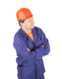 Man in working clothes with crossed arms. Royalty Free Stock Photo