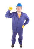 Man in working clothes with fist. Stock Photo