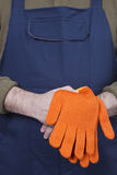 Man in working clothes with gloves. Royalty Free Stock Photo