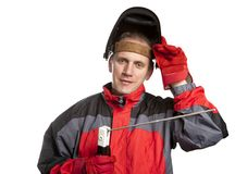 The man in working clothes and a welder mask Royalty Free Stock Photography