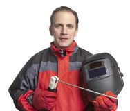 Man in working clothes and a welder mask. Royalty Free Stock Photography