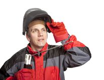 The man in working clothes and a welder mask Royalty Free Stock Image