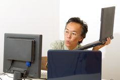 Man working on computer Royalty Free Stock Photos