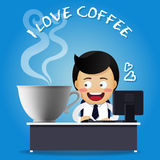 Man working on computer and big coffee cup Royalty Free Stock Images