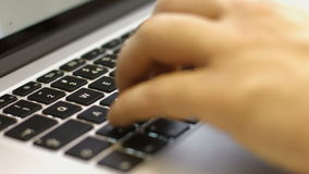The man working at a computer in a cafe. Keyboard typing. Hands touch typing on a laptop keyboard stock video