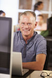 Man Working At Computer In Contemporary Office Stock Image
