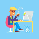 Man is working with computer and drinking coffee. Stock Photos