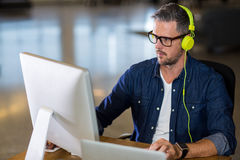 Man working on computer. Focused man working on computer in office Royalty Free Stock Photos