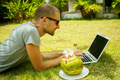 A man working at a computer in nature. Man working at a computer in nature Royalty Free Stock Images