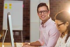 Man working on computer Stock Photo