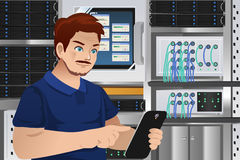 Man Working in Computer Server Room Stock Photo