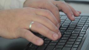A man working at a computer, typing on the keyboard. In the frame of the hand. Shooting with slider movement. Man is typing on the keyboard stock video footage