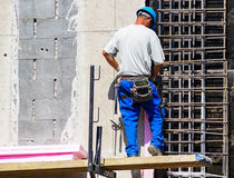 Man is working at the construction site. On a new building royalty free stock photo