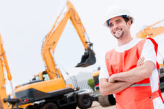 Man working with contruction machines Royalty Free Stock Photo