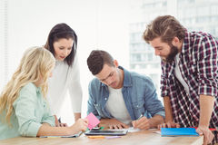 Man working with coworkers Royalty Free Stock Photo