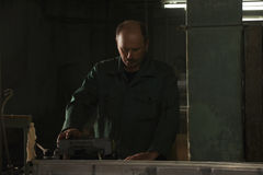 Man working in dark factory Stock Photos