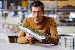 Man working with maquette in design and engineering architecture. Man working in design and engineering architecture office Stock Images