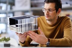 Man working with maquette in design and engineering architecture. Man working in design and engineering architecture office Royalty Free Stock Photo