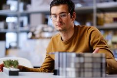 Man working with maquette in design and engineering architecture. Man working in design and engineering architecture office Royalty Free Stock Image