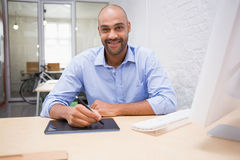 Man working at desk with computer and digitizer Royalty Free Stock Photo