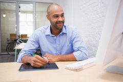 Man working at desk with computer and digitizer Stock Images