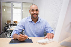 Man working at desk with computer and digitizer Royalty Free Stock Photos
