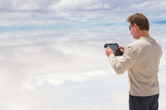 Man working on a digital tablet Stock Images