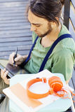 Man working with digital tablet. Young man working with digital tablet Royalty Free Stock Photo