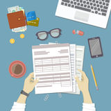 Man working with documents. Human hands hold the accounts, bills, tax form. Workplace with papers, blanks, forms, phone, wallet. With money, credit cards Royalty Free Stock Images