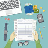 Man working with documents. Men`s hands hold the accounts, payroll, tax form. Workplace Top view. Man working with documents. Men`s hands hold the accounts Royalty Free Stock Photo