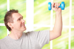Man working with dumbbells Royalty Free Stock Photos