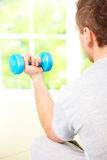 Man working with dumbbells Royalty Free Stock Photography