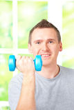 Man working with dumbbells Royalty Free Stock Images