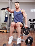 Man working with dumbbells Stock Image