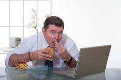 Man working and eat unhealt food Stock Photo