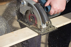 Man is working with electric circular saw Stock Photography