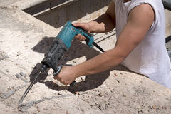 Man working with electric hammer Royalty Free Stock Photography
