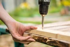 Man working with an electric screwdriver. DIY concept Stock Photos