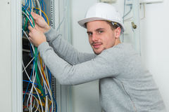 Man working on electric wire. A man working on electric wire Stock Images