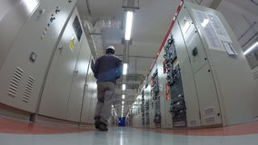 Man working in Electrical substation room stock video