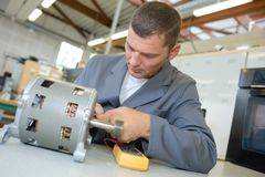 Man working on electrics. Man stock photography