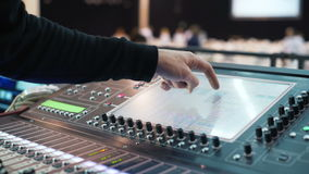 Man working at an event. audio mixer knobs being pulled. hand presses the keys stock footage