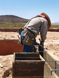 Man Working on Excavation Site - Vertical Royalty Free Stock Photography