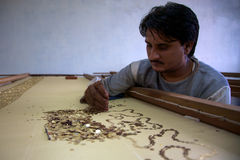 Man working in a fair-trade workshop in Agra Stock Photography