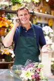 Man working in florist Stock Photography